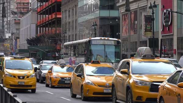 Cars and taxis pass on a Manhattan street in New York City. Royalty-free stock video