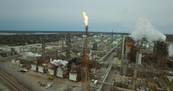 Excellent aerial over huge industrial oil refinery with gas torch burning. Royalty-free stock video