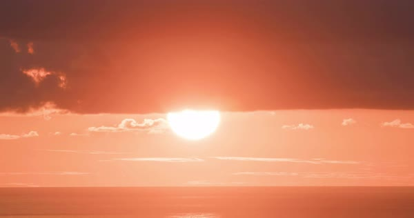 The sun sets in a huge orange ball in time lapse. Royalty-free stock video