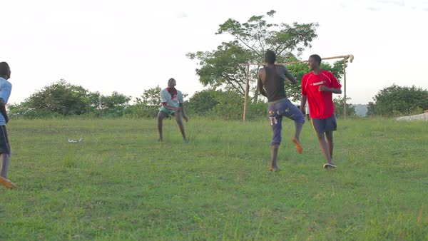 African children play soccer on a grassy field. Royalty-free stock video