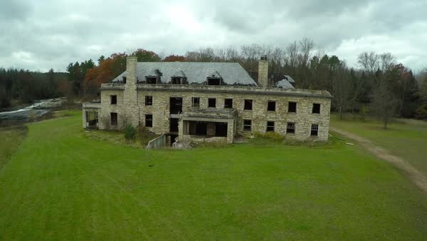 An aerial over a spooky abandoned mansion in the countryside. Royalty-free stock video