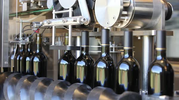 Close up shots of automation along the assembly line inside a wine bottling factory. Royalty-free stock video