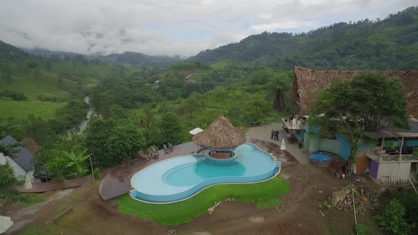 An aerial over a resort or home on the Semuc Champey river in Guatemala. Royalty-free stock video