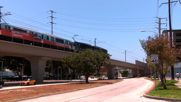 Rapid transit train on elevated railway moves through Los Angeles. Royalty-free stock video
