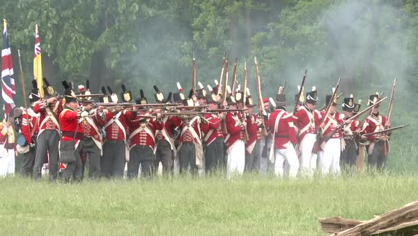 The dead lie on the battlefield while others fight in this television style reenactment of the War of 1812. Royalty-free stock video