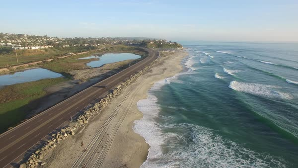 High aerial over the California coastline and highway near San Diego. Royalty-free stock video