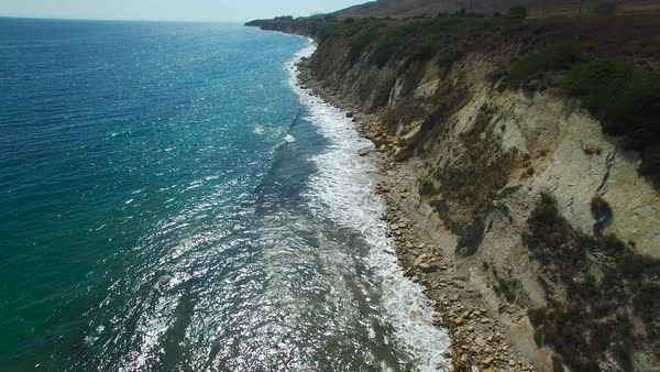 A beautiful long aerial shot along the rugged Central California coastline with sparkling ocean. Royalty-free stock video