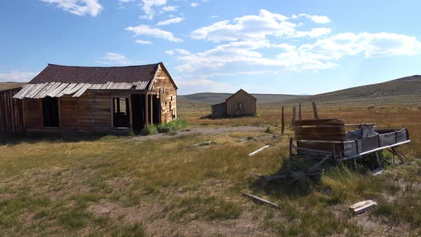 An old abandoned wagon sits in the field in the remarkable ghost town of Bodie, California. Royalty-free stock video