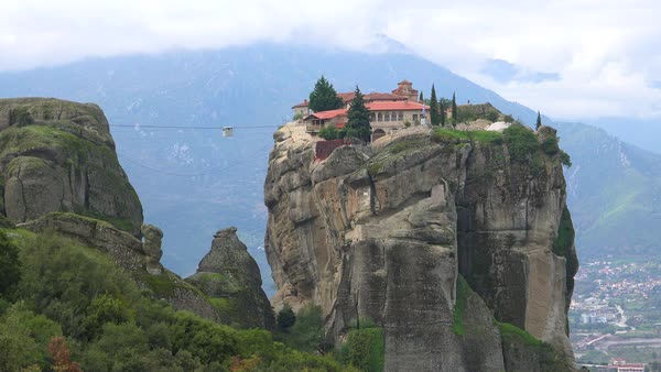 A cable car moves across a chasm to a monastery in Meteroa, Greece. Royalty-free stock video