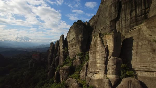 Beautiful aerial in golden light over the rock formations and monasteries of Meteora, Greece. Royalty-free stock video