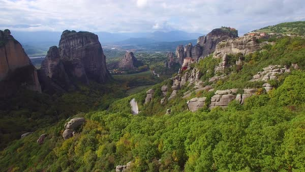 Beautiful aerial over the rock formations and monasteries of Meteora, Greece. Royalty-free stock video