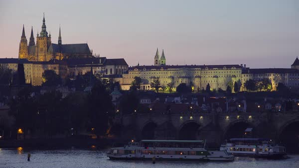 Beautiful sunset establishing shot of the Charles Bridge over the Vltava River in Prague, Czech Republic. Royalty-free stock video