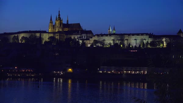 Beautiful night establishing shot of the Charles Bridge over the Vltava River in Prague, Czech Republic. Royalty-free stock video