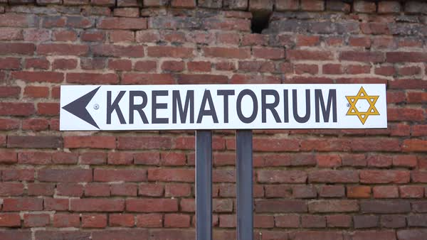 A sign indicates directions to the crematorium at the Terezin Nazi concentration camp in Czech Republic. Royalty-free stock video