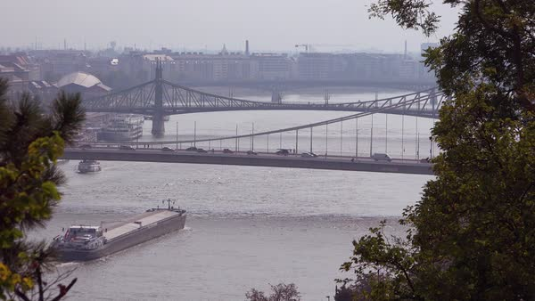A barge travels on the Danube River in Budapest, Hungary. Royalty-free stock video