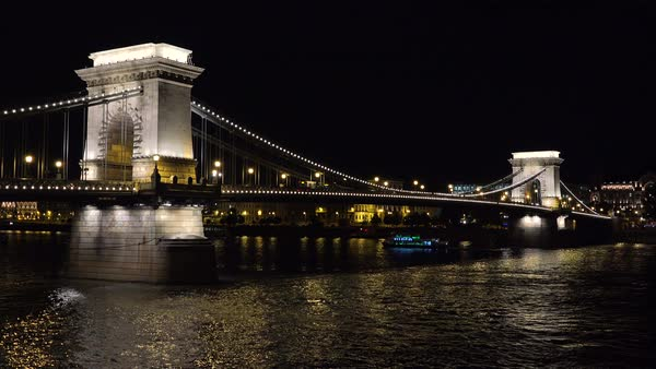 A bridge in evening light along the Danube River in Budapest, Hungary. Royalty-free stock video