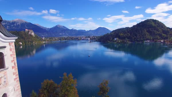 Gorgeous aerial shot flying over Lake Bled and island castle, Slovenia. Royalty-free stock video