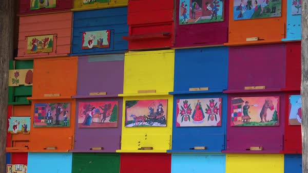 Multicolored bee boxes form a shed house in Slovenia. Royalty-free stock video