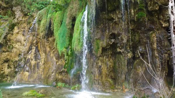 Beautiful waterfalls flow through lush green jungle at Plitvice National Park in Croatia. Royalty-free stock video