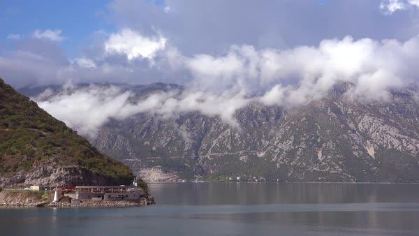 Beautiful mountains rise above the shores of Boka Bay, Montenegro.  Royalty-free stock video
