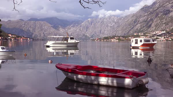 An attractive village and boats on the shores of Boka Bay, Montenegro. Royalty-free stock video