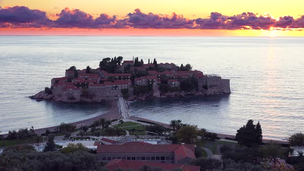 Remarkable high angle sunset shot over the beautiful Sveti Stefan island in Montenegro. Royalty-free stock video
