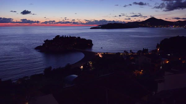 Remarkable high angle night shot over the beautiful Sveti Stefan island in Montenegro. Royalty-free stock video