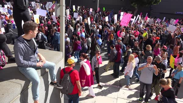 Hundreds of thousands march and carry signs to protest the presidency of Donald Trump in downtown Los Angeles, California. Royalty-free stock video