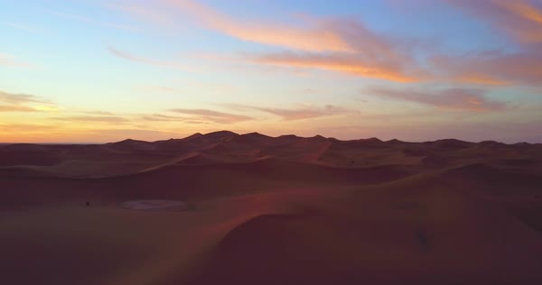 A remarkable aerial over desert sand dunes at sunrise in Morocco. Royalty-free stock video