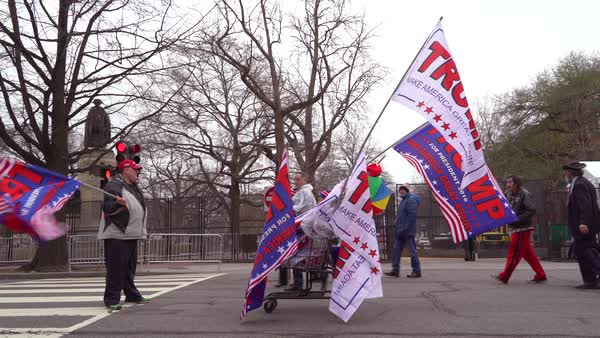 A vendor sells Donald Trump posters and flags from a cart during the Inauguration in Washington DC. Royalty-free stock video