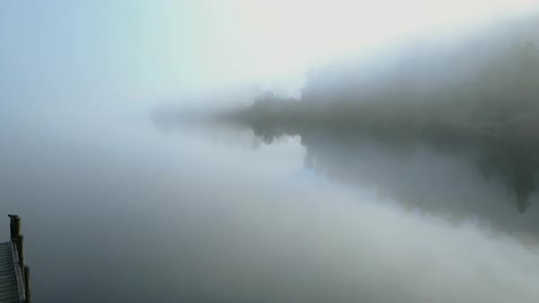 Drone shot of a lake covered in fog Royalty-free stock video