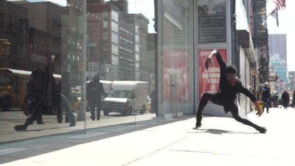 Handheld shot of a man dancing on a street Royalty-free stock video