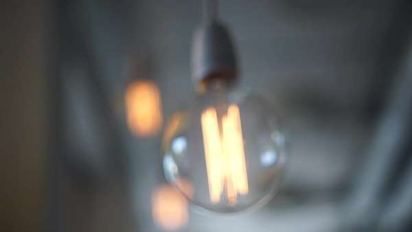 Medium shot of a swaying light bulb Royalty-free stock video