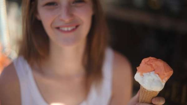 Close-up of young woman eating ice cream Royalty-free stock video