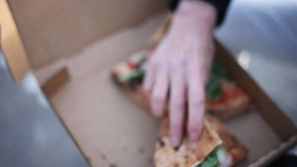 Close-up of man eating a slice of pizza Royalty-free stock video