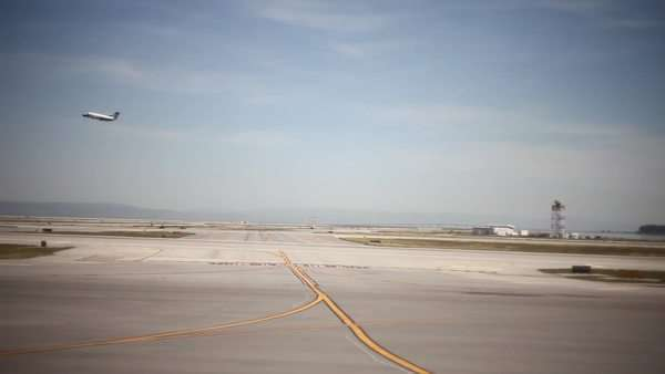 Medium shot of airplane rolling on taxiway seen from window Royalty-free stock video