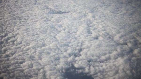Extreme long shot of airplane flying above clouds seen from window Royalty-free stock video