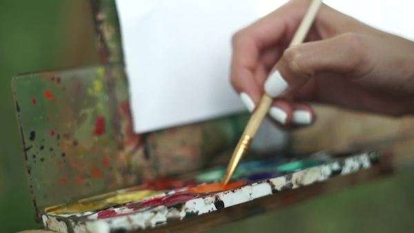 Close-up shot of woman painting on a paper Royalty-free stock video