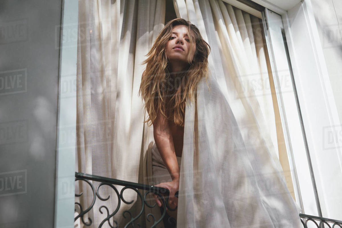 Portrait of a beautiful young woman leaning on a railing Royalty-free stock photo