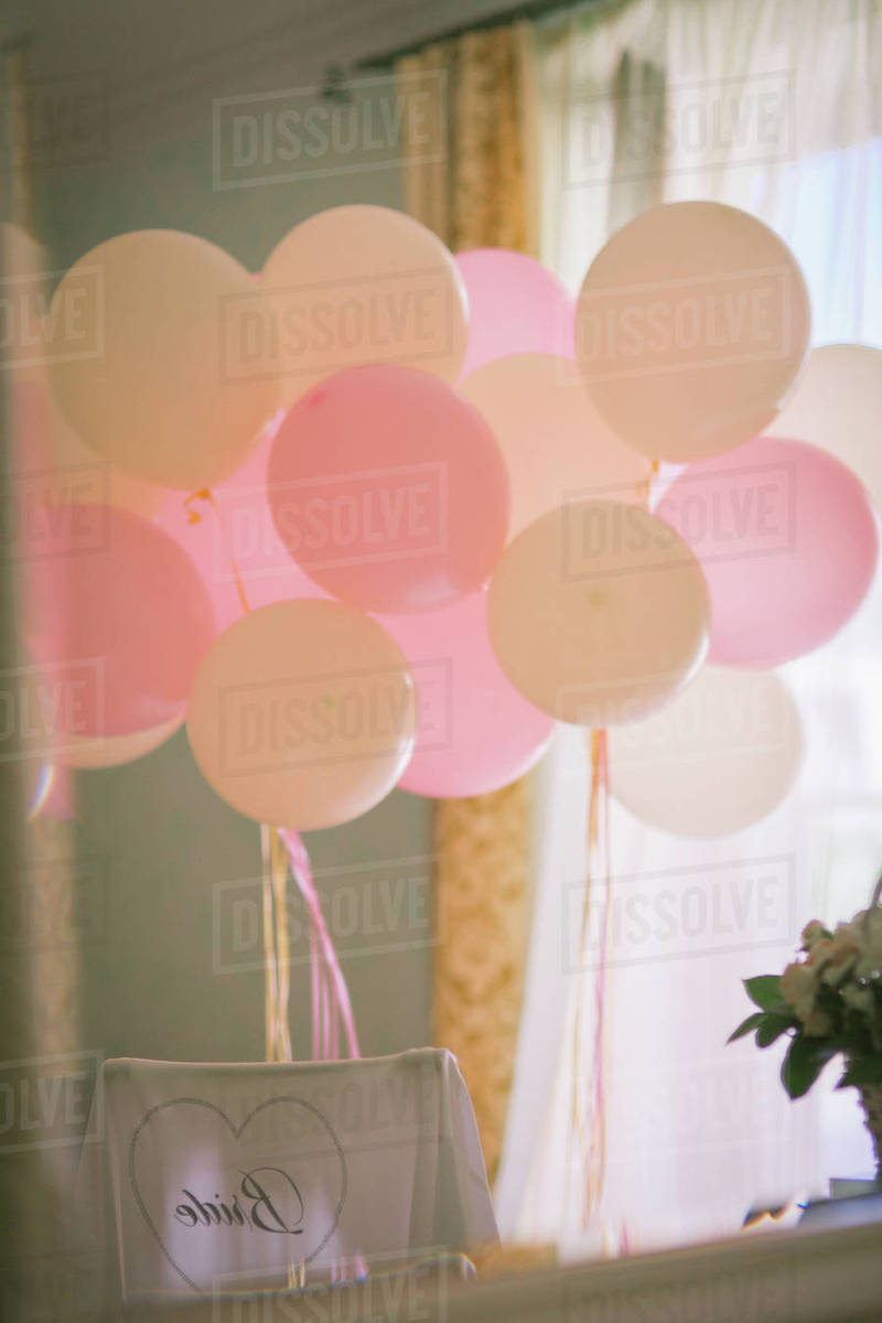 Pink and white balloons inside the room Royalty-free stock photo