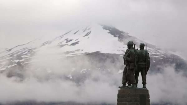 War memorial at Spean Bridge in the Scottish highlands with clouds, snow and mountains in the background Royalty-free stock video