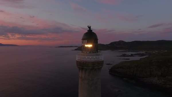 Stunning aerial shot of Ardnamurchan lighthouse on the coast of Scotland during a sunset  Royalty-free stock video