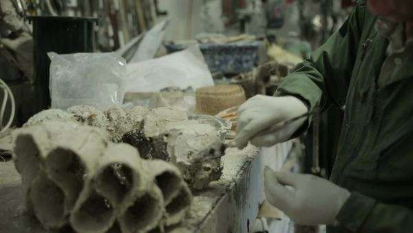 A sculptor in a workshop using clay to create a ruff Royalty-free stock video