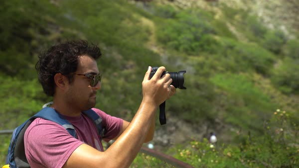 Hand-held shot of a man taking panoramic photos Royalty-free stock video