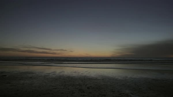 Wide shot of a beach at sunset Royalty-free stock video