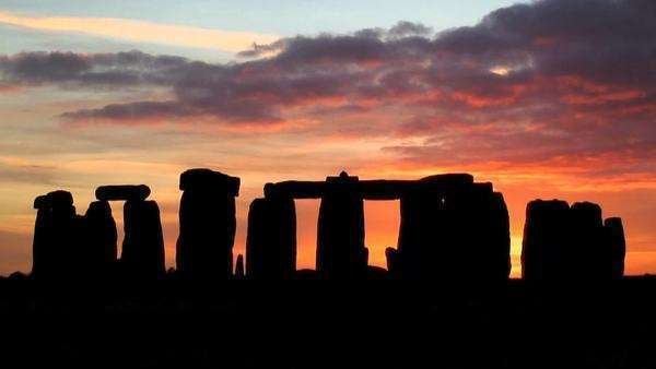 Timelapse Silhouette Sunset over Stonehenge Wiltshire England UK Royalty-free stock video