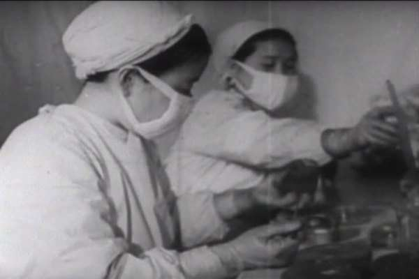 The U.S. uses biological and germ warfare in the Korean War, according to this North Korean propaganda film. Royalty-free stock video