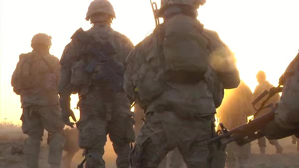 Marines go on patrol in Kandahar Province, Afghanistan and uncover an IED device along the road. Royalty-free stock video