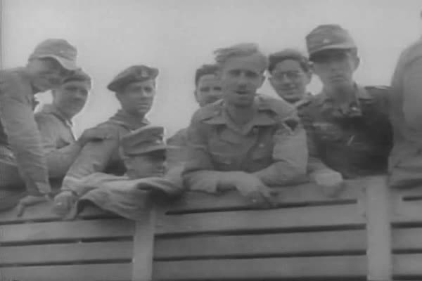 German troops are captured as prisoners of war, and Allied Troops drive through Bizerte and other Tunisian towns, liberating them of Nazi occupation, during WWII. Royalty-free stock video