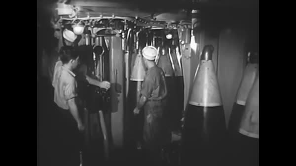 Shells are loaded into guns aboard the Battleship New Jersey as it engages with the Korean enemy during the Korean War in 1952. Royalty-free stock video